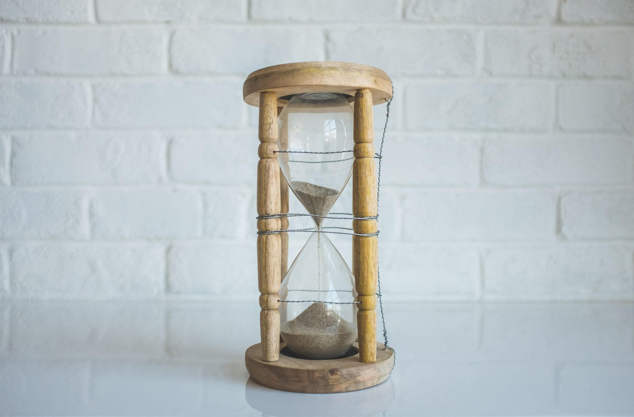 A sand timer showing that time will run out reminding you to pay your tax on time