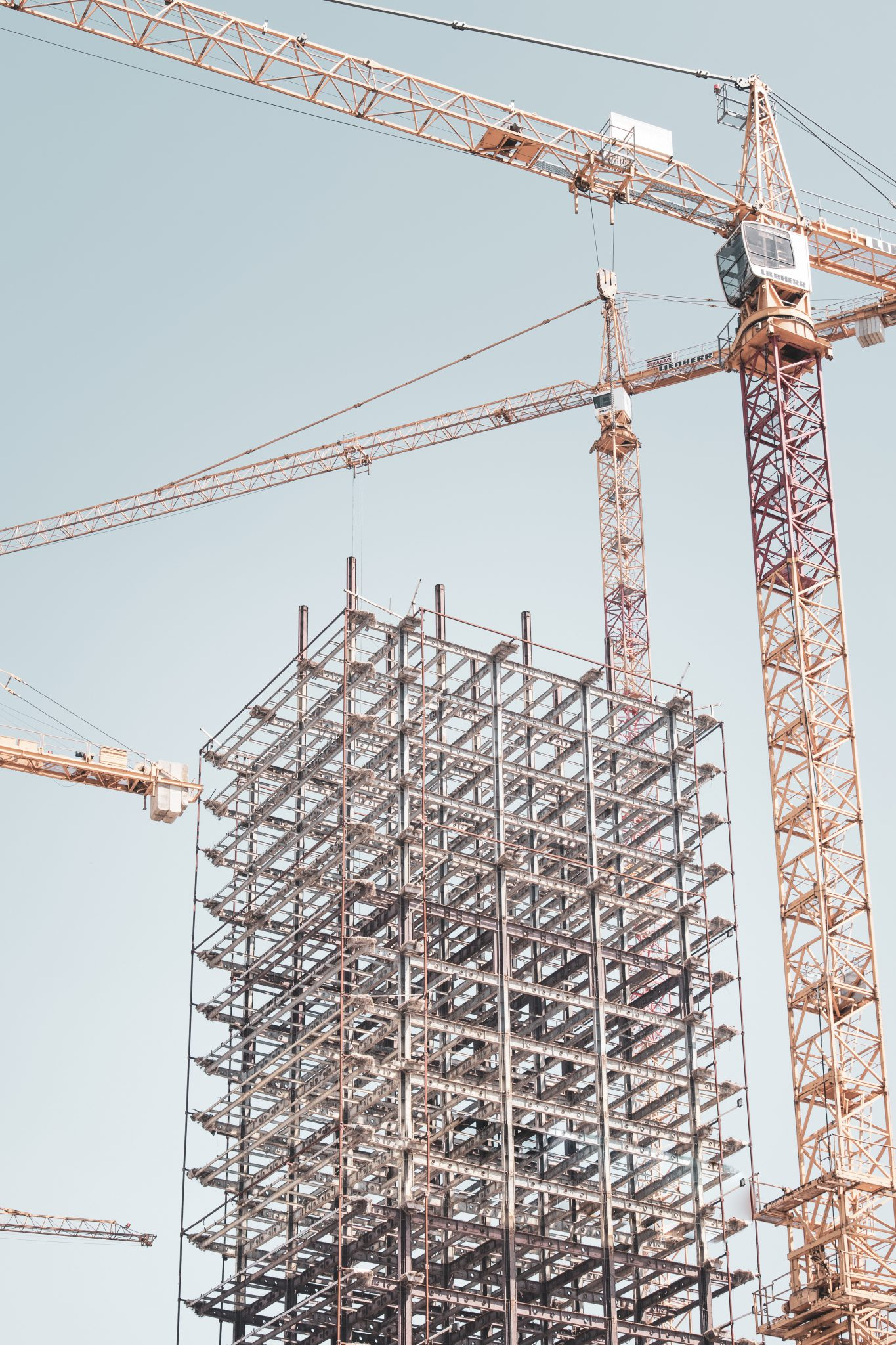 A crane and scaffolding erected showing that it can collapse at any time