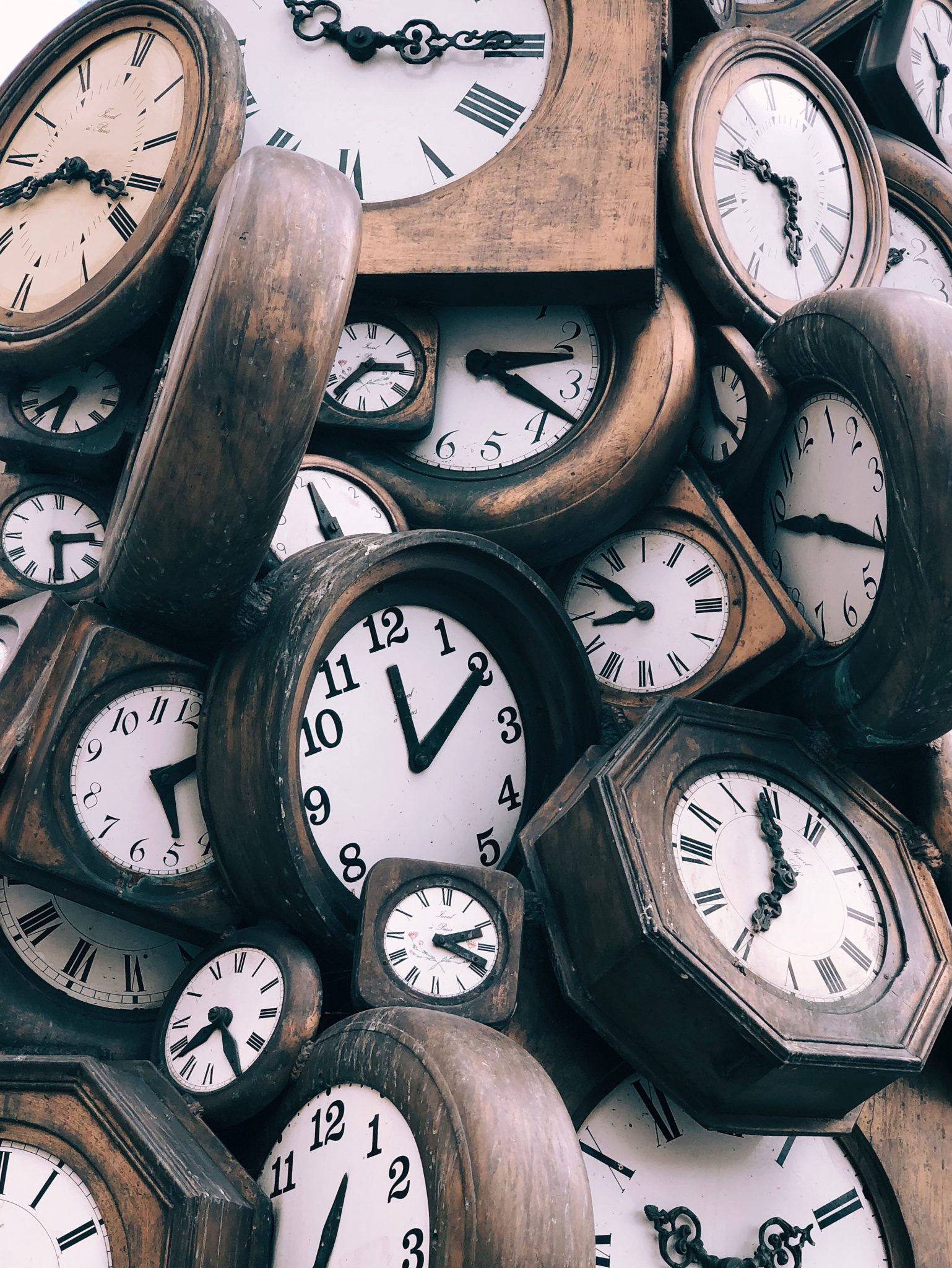 Clocks representing the ticking of time and deadlines for Self-Assessment tax